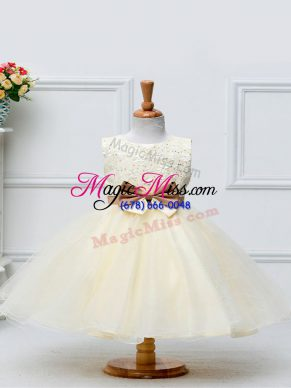 Sleeveless Tulle Knee Length Zipper Little Girls Pageant Dress Wholesale in Champagne with Lace and Bowknot
