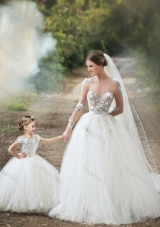 New Style See Through Long Sleeves Wedding Dresses with Appliques and Lovely Big Puffy Flower Girl Dress with Hand Made Flowers